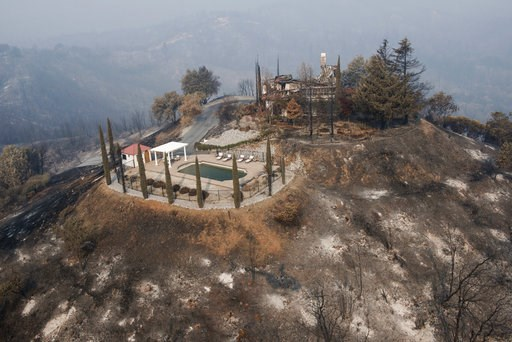 (AP Photo/Michael Burke). A swimming pool is all that remains of a hilltop home after being burned by a wildfire that swept through Shasta County an area west of Redding, Calif., Friday, Aug. 10, 2018.