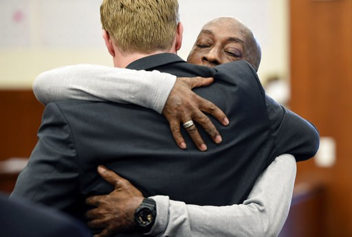 (Josh Edelson/Pool Photo via AP). Plaintiff Dewayne Johnson, facing camera, hugs one of his lawyers after hearing the verdict in his case against Monsanto at the Superior Court of California in San Francisco on Friday, Aug. 10, 2018. A San Francisco ju...
