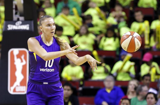 (AP Photo/Elaine Thompson, File). FILE - In this July 10, 2018, file photo, Los Angeles Sparks' Maria Vadeeva passes the ball during the team's WNBA basketball game against the Seattle Storm in Seattle. While she's a rookie to the WNBA, Vadeeva has bee...