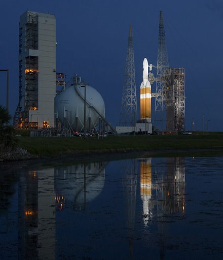 (Bill Ingalls/NASA via AP). This photo provided by NASA shows the United Launch Alliance Delta IV Heavy rocket with the Parker Solar Probe onboard shortly after the Mobile Service Tower was rolled back, Friday, Aug. 10, 2018, at Launch Complex 37 at Ca...