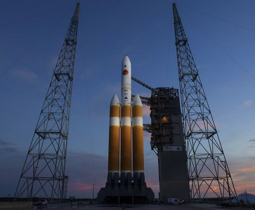 (Bill Ingalls/NASA via AP). This photo provided by NASA shows the United Launch Alliance Delta IV Heavy rocket with the Parker Solar Probe onboard shortly after the Mobile Service Tower was rolled back, Friday, Aug. 10, 2018, Launch Complex 37 at Cape ...