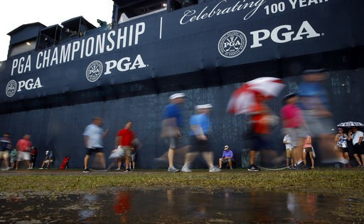 (AP Photo/Charlie Riedel). Patrons leave the course as play was suspended for the rest of the day during the second round of the PGA Championship golf tournament at Bellerive Country Club, Friday, Aug. 10, 2018, in St. Louis. Play was suspended due to ...