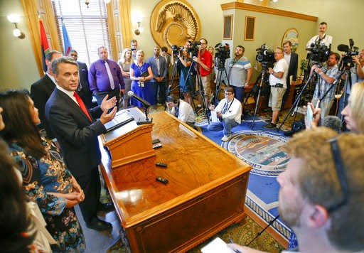 (Chris Neal/The Topeka Capital-Journal via AP). Kansas Gov. Jeff Colyer addresses the media on Wednesday, Aug. 8, 2018, at the Kansas Statehouse in Topeka, Kan. Out-of-power Kansas Democrats smelled opportunity Wednesday in the tight, unsettled GOP pri...