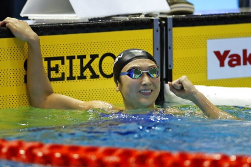(AP Photo/Koji Sasahara). Japan's Rikako Ikee reacts after winning the women's 100m butterfly final during the Pan Pacific swimming championships in Tokyo, Saturday, Aug. 11, 2018.