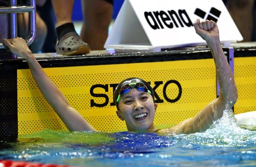 (AP Photo/Koji Sasahara). Japan's Yui Ohashi celebrates after winning the women's 200m individual medley final during the Pan Pacific swimming championships in Tokyo, Saturday, Aug. 11, 2018.