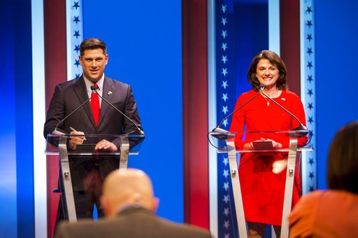 (Tyger Williams/Milwaukee Journal-Sentinel via AP). FILE - In this July 26, 2018, file photo, Republican U.S. Senate candidates Leah Vukmir, right, and Kevin Nicholson debate in Milwaukee. Nicholson, running as an outsider, is running against Vukmir, a...