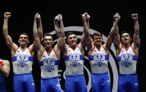 (AP Photo/Darko Bandic). Members of the Russian team hold up their gold medals after placing first in the men's artistic gymnastics team finals at the European Championships in Glasgow, Scotland, Saturday, Aug. 11, 2018. From left, Nikita Nagornyy, Dav...