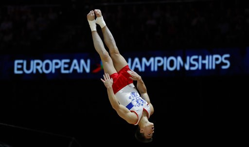 (AP Photo/Darko Bandic). Nikita Nagornyy of Russia competes on the pommel horse during the men's artistic gymnastics team finals at the European Championships in Glasgow, Scotland, Saturday, Aug. 11, 2018.