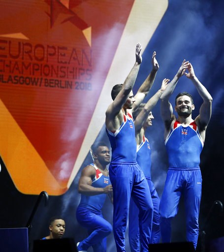(AP Photo/Darko Bandic). Members of the Great Britain team come to the stage to collect their silver medals after placing second in the men's artistic gymnastics team finals at the European Championships in Glasgow, Scotland, Saturday, Aug. 11, 2018. F...