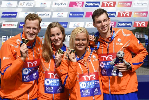 (Ian Rutherford/PA via AP). The Netherlands' team Ferry Weertman, Esmee Vermeulen, Sharon Van Rouwendaal and Pepijn Maxime Smits pose for a photo as they celebrate winning the Open Water Mixed Relay swim during the European Championships at Loch Lomond...