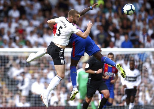 (Yui Mok/PA via AP). Fulham's Calum Chambers, left, and Crystal Palace's Max Meyer in action during their English Premier League soccer match at Craven Cottage in London, Saturday Aug. 11, 2018.