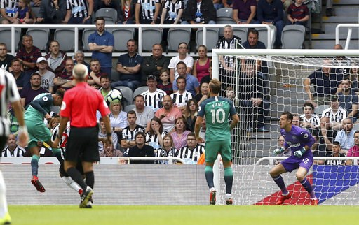 (Owen Humphreys/PA via AP). Tottenham's Dele Alli, left, scores his side's second goal of the game against Newcastle during their English Premier League soccer match at St James' Park in Newcastle, England, Saturday Aug. 11, 2018.