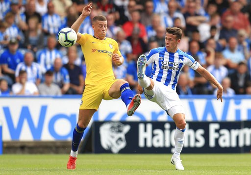 (Mike Egerton/PA via AP). Chelsea's Ross Barkley, left, and Huddersfield Town's Jonathan Hogg in action during their English Premier League soccer match at the John Smith's Stadium in Huddersfield, England, Saturday Aug. 11, 2018.
