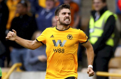 (Nick Potts/PA via AP). Wolverhampton Wanderers' Ruben Neves celebrates scoring his side's first goal of the game against Everton, during their English Premier League soccer match at Molineux in Wolverhampton, England, Saturday Aug. 11, 2018.