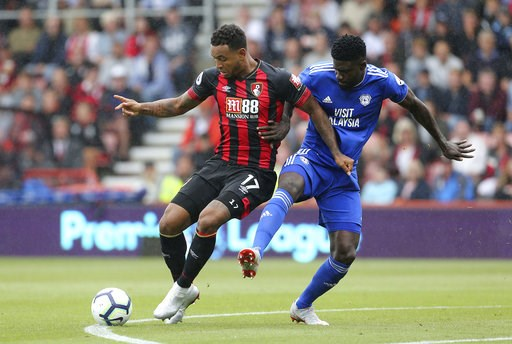 (Mark Kerton/PA via AP). Bournemouth's Joshua King, left, and Cardiff City's Bruno Ecuele Manga in action during their English Premier League soccer match at the Vitality Stadium in Bournemouth, England, Saturday Aug. 11, 2018.