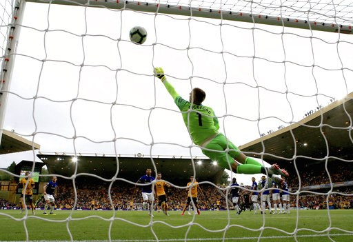 (Nick Potts/PA via AP). Everton goalkeeper Jordan Pickford fails to stop the ball as Wolverhampton Wanderers' Ruben Neves scores his side's first goal of the game during their English Premier League soccer match at Molineux in Wolverhampton, England, S...