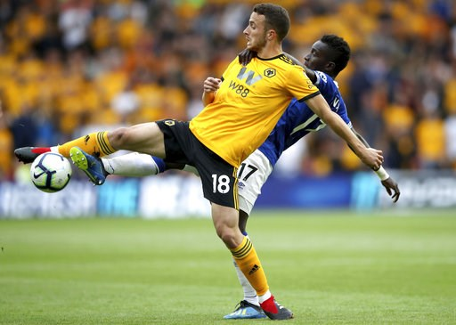 (Nick Potts/PA via AP). Wolverhampton Wanderers' Diogo Jota, front, and Everton's Idrissa Gueye reach for the ball during their English Premier League soccer match at Molineux in Wolverhampton, England, Saturday Aug. 11, 2018.
