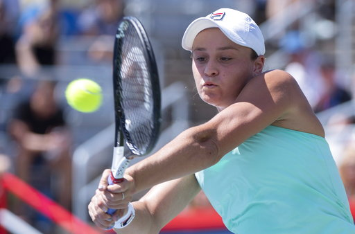 (Paul Chiasson/The Canadian Press via AP). Ashleigh Barty of Australia returns to Simona Halep of Romania during semifinals play at the Rogers Cup tennis tournament Saturday, Aug. 11, 2018 in Montreal.
