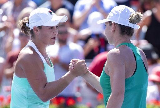 (Paul Chiasson/The Canadian Press via AP). Ashleigh Barty of Australia, left, congratulates Simona Halep of Romania for her victory in semifinals play at the Rogers Cup tennis tournament Saturday, Aug. 11, 2018 in Montreal.