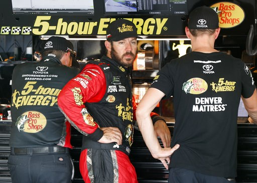 (AP Photo/Paul Sancya). Martin Truex Jr. watches his crew work during practice for a NASCAR Cup Series auto race at Michigan International Speedway in Brooklyn, Mich., Saturday, Aug. 11, 2018.