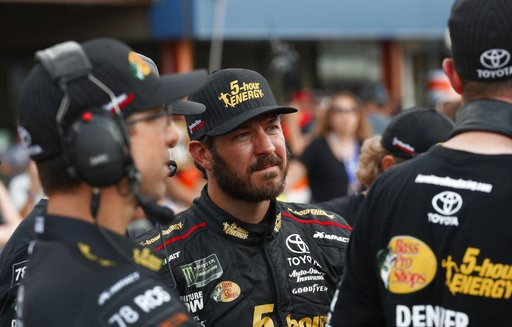 (AP Photo/Paul Sancya). Martin Truex Jr. watches times during qualifications for a NASCAR Cup Series auto race at Michigan International Speedway in Brooklyn, Mich., Friday, Aug. 10, 2018.