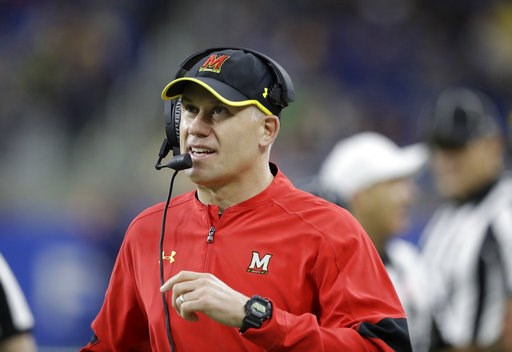 (AP Photo/Carlos Osorio, File). FILE - In this Dec. 26, 2016, file photo, Maryland head coach DJ Durkin walks the sideline during the first half of the Quick Lane Bowl NCAA college football game against Boston College in Detroit. Maryland placed the he...
