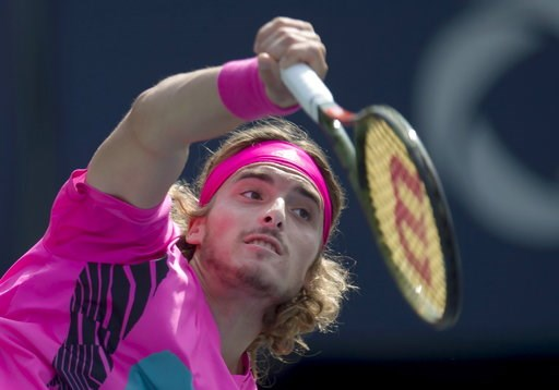 (Frank Gunn/The Canadian Press via AP). Stefanos Tsitsipas of Greece serves to Kevin Anderson of South Africa during Rogers Cup semifinal tennis tournament action in Toronto on Saturday, Aug. 11, 2018 in Montreal.