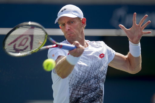 (Frank Gunn/The Canadian Press via AP). Kevin Anderson of South Africa hits a forehand to Stefanos Tsitsipas of Greece during Rogers Cup semifinal tennis tournament action in Toronto on Saturday, Aug. 11, 2018 in Montreal.