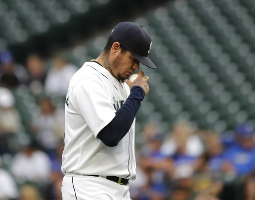 (AP Photo/Ted S. Warren). Seattle Mariners starting pitcher Felix Hernandez makes a crossing gesture while he holds the baseball as he takes the mound at the start of the team's baseball game against the Toronto Blue Jays, Thursday, Aug. 2, 2018, in Se...