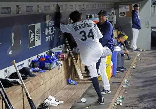 (AP Photo/Ted S. Warren). Seattle Mariners pitching coach Mel Stottlemyre talks with starting pitcher Felix Hernandez (34) in the dugout after the top of the fifth inning of the team's baseball game against the Toronto Blue Jays, Thursday, Aug. 2, 2018...