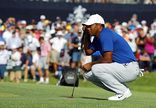 (AP Photo/Brynn Anderson). Tiger Woods looks at his putt on the 18th green during the third round of the PGA Championship golf tournament at Bellerive Country Club, Saturday, Aug. 11, 2018, in St. Louis.