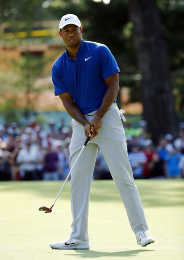 (AP Photo/Charlie Riedel). Tiger Woods looks at his putt on the 15th green during the third round of the PGA Championship golf tournament at Bellerive Country Club, Saturday, Aug. 11, 2018, in St. Louis.