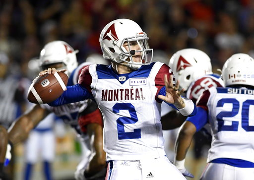 (Justin Tang/The Canadian Press via AP). Montreal Alouettes quarterback Johnny Manziel (2) passes during first-half CFL football game action against the Ottawa Redblacks in Ottawa, Ontario, Saturday, Aug. 11, 2018.