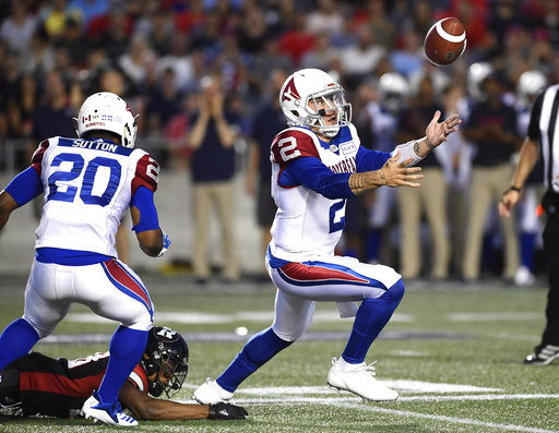 (Justin Tang/The Canadian Press via AP). Montreal Alouettes quarterback Johnny Manziel (2) loses control of the ball under pressure from Ottawa Redblacks' Corey Tindal (28) during the half of a Canadian Football League game Saturday, Aug. 11, 2018, in ...
