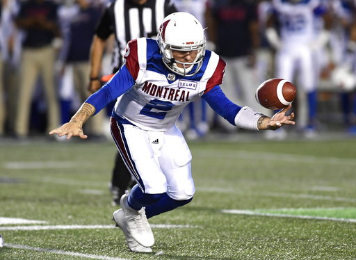 (Justin Tang/The Canadian Press via AP). Montreal Alouettes quarterback Johnny Manziel (2) loses control of the ball during the half of a Canadian Football League game against the Ottawa Redblacks on Saturday, Aug. 11, 2018, in Ottawa, Ontario.