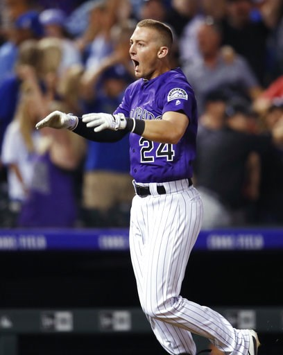 (AP Photo/David Zalubowski). Colorado Rockies' Ryan McMahon yells as he circles the bases after hitting a three-run, walk-off home run off Los Angeles Dodgers relief pitcher JT Chargois in a baseball game Saturday, Aug. 11, 2018, in Denver.