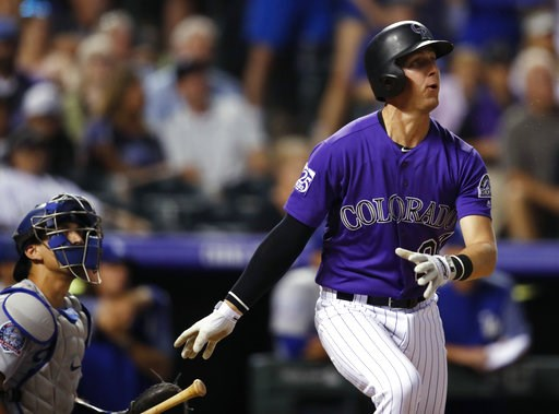 (AP Photo/David Zalubowski). Colorado Rockies' Ryan McMahon watches his three-run, walk-off home run off Los Angeles Dodgers relief pitcher JT Chargois  during a baseball game Saturday, Aug. 11, 2018, in Denver. The Rockies won 3-2.