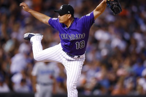 (AP Photo/David Zalubowski). Colorado Rockies relief pitcher Seunghwan Oh works against the Los Angeles Dodgers in the eighth inning of a baseball game Saturday, Aug. 11, 2018, in Denver.
