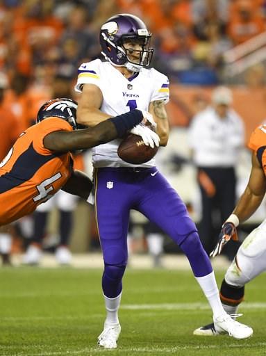 (AP Photo/Mark Reis). Denver Broncos linebacker Jeff Holland, left, sacks Minnesota Vikings quarterback Kyle Sloter during the second half in an NFL football preseason game Saturday, Aug. 11, 2018, in Denver.