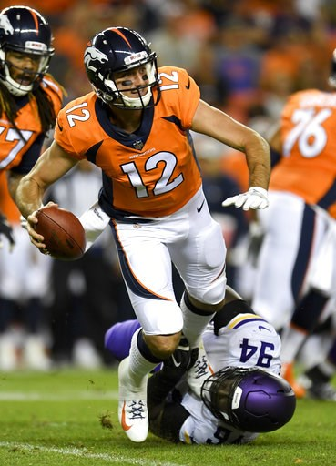 (AP Photo/Mark Reis). Denver Broncos quarterback Paxton Lynch gets sacked by Minnesota Vikings defensive tackle Jaleel Johnson during the first half in an NFL football preseason game Saturday, Aug. 11, 2018, in Denver.