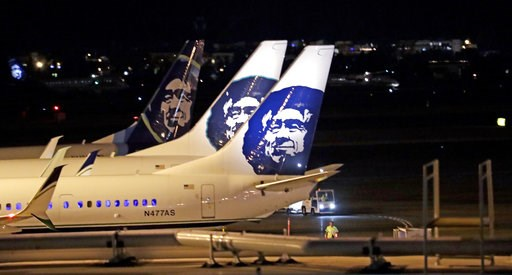 (AP Photo/Elaine Thompson). Alaska Airlines planes sit on the tarmac at Sea-Tac International Airport Friday evening, Aug. 10, 2018, in SeaTac, Wash. An airline mechanic stole an Alaska Airlines plane without any passengers and took off from Sea-Tac In...
