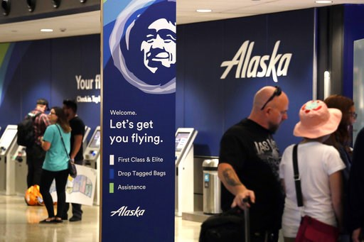 (AP Photo/Elaine Thompson). People stand in the Alaska Airlines ticket area at Sea-Tac International Airport Friday, Aug. 10, 2018, in SeaTac, Wash.An airline mechanic stole an Alaska Airlines plane without any passengers and took off from Sea-Tac Inte...