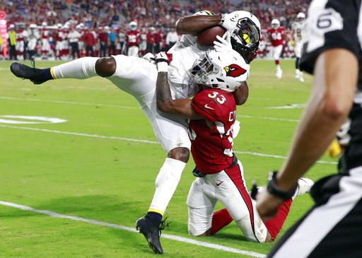 (AP Photo/Rick Scuteri). Los Angeles Chargers wide receiver Geremy Davis pulls in a touchdown pass as Arizona Cardinals defensive back Chris Campbell (33) defends during the second half of a preseason NFL football game, Saturday, Aug. 11, 2018, in Glen...