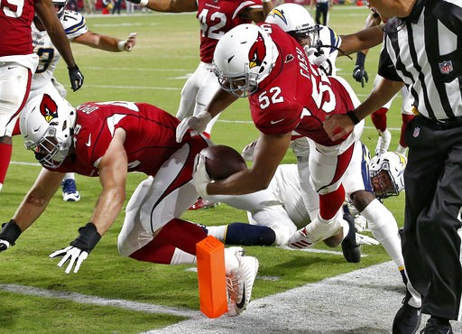 (AP Photo/Ross D. Franklin). Arizona Cardinals linebacker Jeremy Cash (52) runs back a fumble recovery for a touchdown against the Los Angeles Chargers during the second half of a preseason NFL football game, Saturday, Aug. 11, 2018, in Glendale, Ariz.