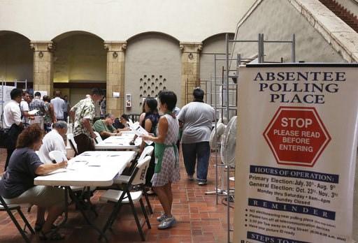 (AP Photo/Jennifer Sinco Kelleher). In this Thursday, Aug. 9, 2018, photo, voters sign in to vote at an early polling location in Honolulu. Hawaii's weekend primary election will most likely settle the outcome of this year's major races.