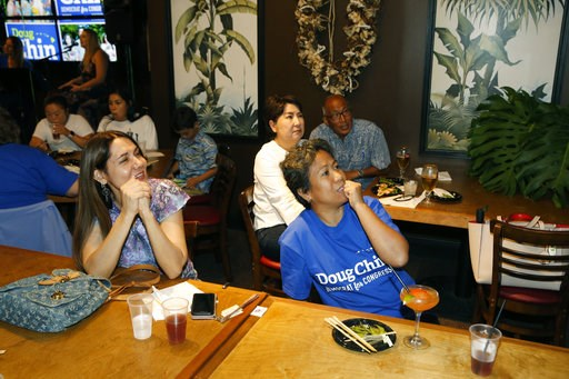 (AP Photo/Marco Garcia). Guests at Hawaii Lt. Gov. Doug Chin's campaign party react to election results, Saturday, Aug. 11, 2018, in Honolulu.