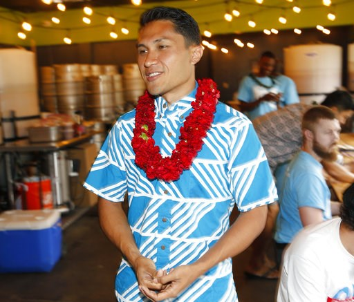 (AP Photo/Marco Garcia). Kaniela Ing, a candidate for Hawaii's 1st Congressional District seat, walks into a bar hosting his campaign party, Saturday, Aug. 11, 2018, in Honolulu.