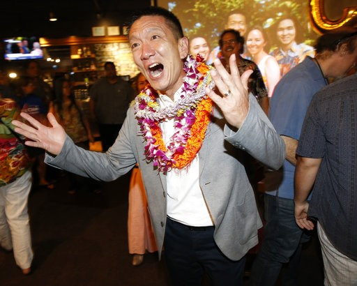 (AP Photo/Marco Garcia). Hawaii Lt. Gov. Doug Chin, a candidate for Hawaii's 1st Congressional District seat, greats guests at his campaign party, Saturday, Aug. 11, 2018, in Honolulu.