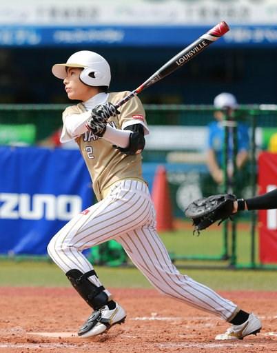 (Kyodo News via AP). Japan's Saki Yamazaki hits an inside-the-park home run in the third inning during a women's world softball championship game against Canada, in Chiba, near Tokyo Sunday, Aug. 12, 2018.