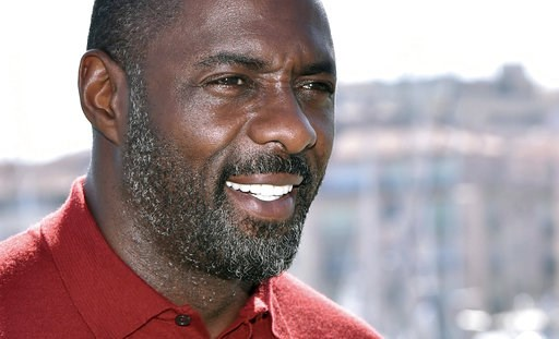 (AP Photo/FILE). FILE - In this file photo dated Tuesday, April 14, 2015, actor Idris Elba poses for photographers during the MIPTV, International Television Programme Market, in Cannes, southern France.  British actor Idris Elba has stoked speculation...